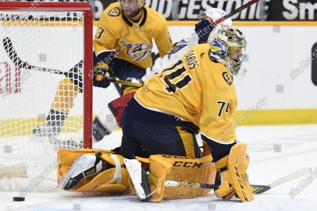 Nashville Predators goaltender Juuse Saros (74) reacts after Columbus Blue Jackets right wing Cam Atkinson (13) scored a goal during first period of an NHL hockey game, in Nashville, Tenn