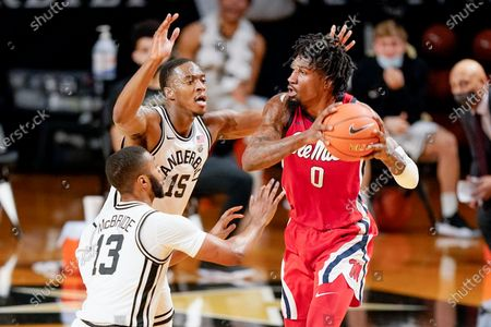 Stock Picture of Mississippi's Romello White (0) looks for a way past Vanderbilt defenders Clevon Brown (15) and Issac McBride (13) in the first half of an NCAA college basketball game, in Nashville, Tenn