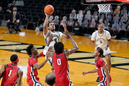 Vanderbilt's Jordan Wright (4) shoots over Mississippi's Romello White (0) in the first half of an NCAA college basketball game, in Nashville, Tenn