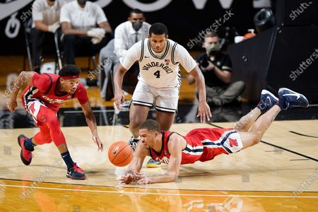 Mississippi's Devontae Shuler, left, and KJ Buffen, right, reach for a loose ball with Vanderbilt's Jordan Wright (4) in the first half of an NCAA college basketball game, in Nashville, Tenn