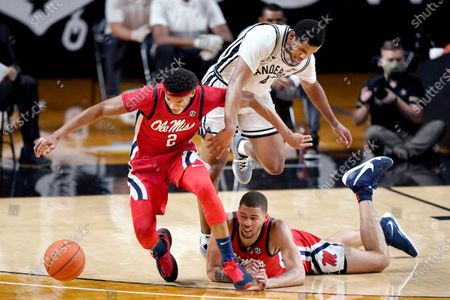 Mississippi's Devontae Shuler (2) and KJ Buffen, right, chase a loose ball with Vanderbilt's Jordan Wright (4) in the first half of an NCAA college basketball game, in Nashville, Tenn
