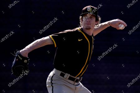San Diego Padres pitcher Tim Hill throws during spring training baseball practice, in Peoria, Ariz