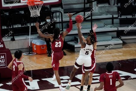 Mississippi State guard Deivon Smith (5) shoots past a block attempt by Alabama guard John Petty Jr. (23) during the second half of an NCAA college basketball game in Starkville, Miss