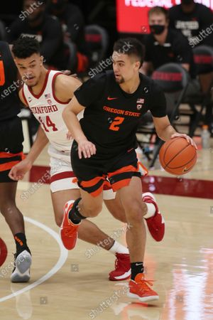 Stock Image of Oregon State guard Jarod Lucas (2) dribbles past Stanford forward Spencer Jones (14) during the second half of an NCAA college basketball game in Stanford, Calif
