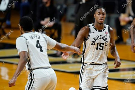 Vanderbilt's Clevon Brown (15) is congratulated by Jordan Wright (4) after a score against Mississippi in the second half of an NCAA college basketball game, in Nashville, Tenn
