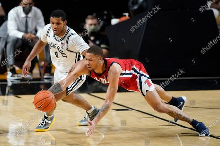 Mississippi's \KJ Buffen, right, reaches for a loose ball with Vanderbilt's Jordan Wright (4) in the first half of an NCAA college basketball game, in Nashville, Tenn