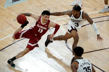 Alabama guard Jahvon Quinerly (13) drives between Mississippi State guard D.J. Stewart Jr. (3) and forward Tolu Smith (35) during the second half of an NCAA college basketball game in Starkville, Miss., . Alabama won 64-59