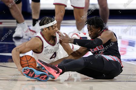Gonzaga guard Aaron Cook, left, and Loyola Marymount guard Jalin Anderson go after the ball during the first half of an NCAA college basketball game in Spokane, Wash