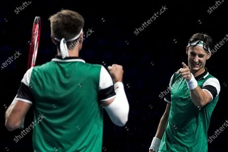 Stock Photo of Sander Gille (L) and Joran Vliegen (R) of Belgium celebrate their win against Matthew Ebden and John-Patrick Smith of Australia during their men's doubles finals match of the Singapore Tennis Open ATP 250 held at the OCBC Arena in Singapore,  28 February 2021.