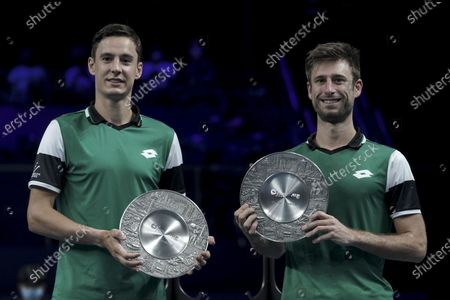Stock Image of Joran Vliegen (L) and Sander Gille (R) of Belgium hold their trophies after winning their men's doubles finals match against Matthew Ebden and John-Patrick Smith of Australia at the Singapore Tennis Open ATP 250 held at the OCBC Arena in Singapore, 28 February 2021.