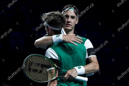 Stock Picture of Sander Gille (C-L) and Joran Vliegen (C-R) of Belgium celebrate their win against Matthew Ebden and John-Patrick Smith of Australia during their men's doubles finals match of the Singapore Tennis Open ATP 250 held at the OCBC Arena in Singapore, 28 February 2021.