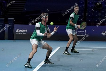 Sander Gille (L) and Joran Vliegen (R) of Belgium in action against Matthew Ebden and John-Patrick Smith of Australia during their men's doubles finals match of the Singapore Tennis Open ATP 250 held at the OCBC Arena in Singapore, 28 February 2021.