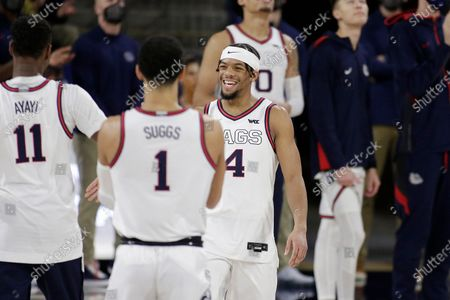 Gonzaga guard Aaron Cook (4), a senior playing his last home game, greets guard Jalen Suggs (1) during introductions before the team's NCAA college basketball game against Loyola Marymount in Spokane, Wash