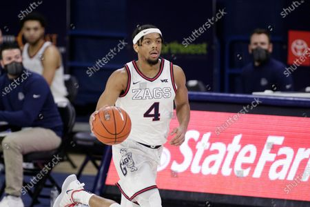 Gonzaga guard Aaron Cook brings the ball up the court during the first half of an NCAA college basketball game against Loyola Marymount in Spokane, Wash