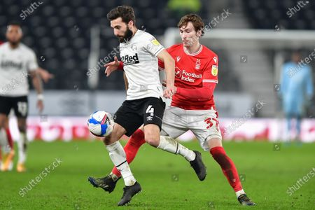 GraemeShinnie of Derby County shields the ball from James Garner (37) of Nottingham Forest during the Sky Bet Championship match between Derby County and Nottingham Forest at the Pride Park, Derby on Friday 26th February 2021.  (Photo by Jon Hobley/MI News/NurPhoto)