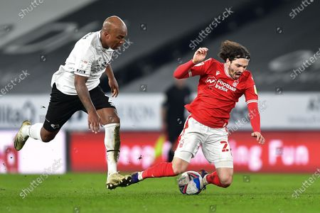 Andre Wisdom of Derby County and James Garner (37) of Nottingham Forest during the Sky Bet Championship match between Derby County and Nottingham Forest at the Pride Park, Derby on Friday 26th February 2021.  (Photo by Jon Hobley/MI News/NurPhoto)