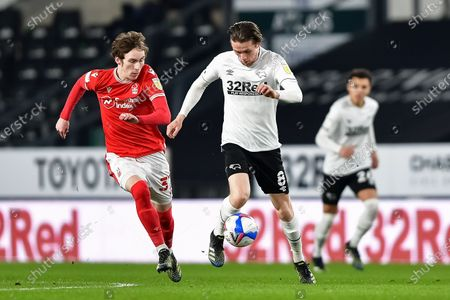 Max Bird of Derby County and James Garner (37) of Nottingham Forest in action during the Sky Bet Championship match between Derby County and Nottingham Forest at the Pride Park, Derby on Friday 26th February 2021.  (Photo by Jon Hobley/MI News/NurPhoto)
