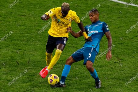 Wilmar Barrios (R) of Zenit Saint Petersburg and Ali Sowe of Rostov vie for the ball during the Russian Premier League match between FC Zenit Saint Petersburg and FC Rostov Rostov-on-Don on February 27, 2021 at Gazprom Arena in Saint Petersburg, Russia. (Photo by Mike Kireev/NurPhoto)