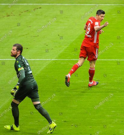 Robert Lewandowski (R) of Bayern Munich celebrates his first scoring during a German Bundesliga match between Bayern Munich and 1. FC Koeln in Munich, Germany, Feb. 27, 2021.