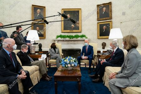 President Joe Biden speaks during a meeting with lawmakers on investments in infrastructure, in the Oval Office of the White House in Washington. From left, Sen. Ben Cardin, D-Md., Sen. Jim Inhofe, R-Okla., Vice President Kamala Harris, Biden, Sen. Tom Carper, D-Del., and Sen. Shelley Moore Capito, R-W.Va. Looking beyond the $1.9 trillion COVID relief bill, Biden and lawmakers are laying the groundwork for another of his top legislative priorities - a long-sought boost to the nation's roads, bridges and other infrastructure that could meet GOP resistance to a hefty price tag