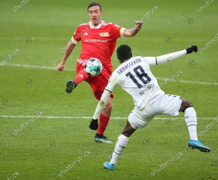 Union's Max Kruse (L) in action against Hoffenheim's Diadie Samassekou (R) during the German Bundesliga soccer match between FC Union Berlin and TSG Hoffenheim 1899 in Berlin, Germany, 28 February 2021.