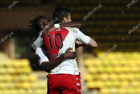 Stevan Jovetic (R) of Monaco celebrates with teammate Aurelien Tchouameni (L) after scoring the 1-0 lead during the French Ligue 1 soccer match between AS Monaco and Stade Brest at Stade Louis II in Monaco, 28 February 2021.