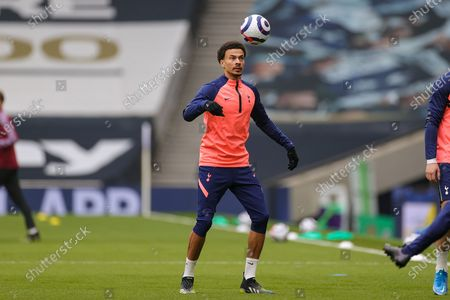 Dele Alli (20) of Tottenham Hotspur warms up during the Premier League match between Tottenham Hotspur and Burnley at Tottenham Hotspur Stadium, London