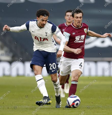 Dele Alli (L) of Tottenham in action against Jack Cork (R) of Burnley during the English Premier League soccer match between Tottenham Hotspur and Burnley FC in London, Britain, 28 February 2021.