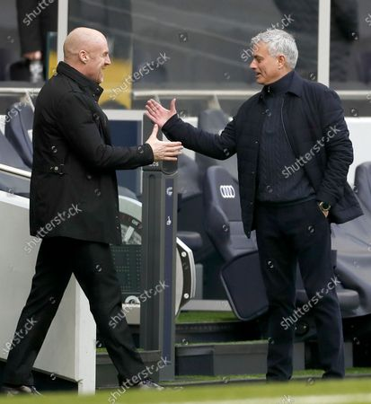Tottenham manager Jose Mourinho (R) greets Burnley manager Sean Dyche (L) prior to the English Premier League soccer match between Tottenham Hotspur and Burnley FC in London, Britain, 28 February 2021.