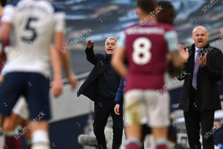 Tottenham's manager Jose Mourinho, centre, reacts next to Burnley's manager Sean Dyche, right, during an English Premier League soccer match between Tottenham Hotspur and Burnley at the Tottenham Hotspur Stadium in London, England, Sunday, Feb. 28. 2021