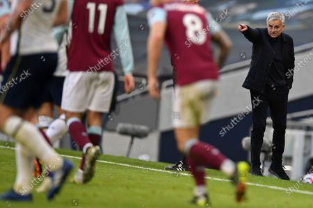 Stock Image of Tottenham's manager Jose Mourinho, right, points during an English Premier League soccer match between Tottenham Hotspur and Burnley at the Tottenham Hotspur Stadium in London, England, Sunday, Feb. 28. 2021