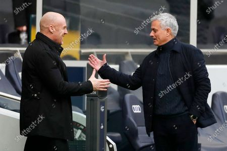 Burnley's manager Sean Dyche, left and Tottenham's manager Jose Mourinho shake hands before the start of an English Premier League soccer match between Tottenham Hotspur and Burnley at the Tottenham Hotspur Stadium in London, England, Sunday, Feb. 28. 2021