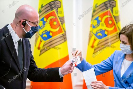 European Council President Charles Michel (L) receives a martisor from Moldova's President Maia Sandu (R) at State Residence during his official visit in Chisinau, Moldova, 28 February 2021. A 'Martisor' is a traditional souvenir in Moldova and Romania, a sign of the upcoming spring.