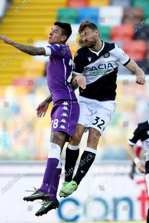 Udinese's Fernando Llorente (R) and Fiorentina's Erick Pulgar in action during the Italian Serie A soccer match Udinese Calcio vs ACF Fiorentina at the Friuli - Dacia Arena stadium in Udine, Italy, 28 February 2021.