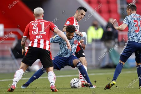(L-R)  Philipp Max of PSV Eindhoven, Devyne Rensch of Ajax, Eran Zahavi of PSV Eindhoven and Antony Matheus Dos Santos or Ajax in action during the Dutch Eredivisie soccer match between PSV Eindhoven and Ajax Amsterdam at the Phillips stadium in Eindhoven, The Netherlands, 28 February 2021.