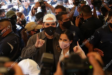 El Salvador's President, Nayib Bukele (L), arrives with his wife, Gabriela Rodriguez, to cast his vote at the polling station on Boulevard Del Hipodromo, in San Salvador, El Salvador, 28 February 2021. More than 5.3 million Salvadorans are summoned this Sunday to elect 84 deputies of the Legislative Assembly, 262 municipal councils and 20 members of the Central American Parliament (Parlacen).