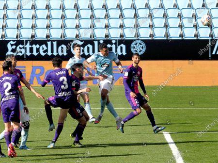 Vigo's Jeison Murillo (2-R) scores the 1-1 equalizer during the Spanish La Liga soccer match between Celta Vigo and Real Valladolid at Balaidos Stadium in Vigo, northwestern Spain, 28 February 2021.