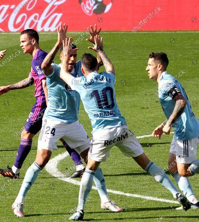 Vigo's Jeison Murillo (2-L) celebrates with teammates after scoring the 1-1 equalizer during the Spanish La Liga soccer match between Celta Vigo and Real Valladolid at Balaidos Stadium in Vigo, northwestern Spain, 28 February 2021.