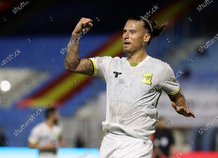 Al-Ittihad's player Aleksandar Prijovic celebrates after scoring a goal during the Saudi Professional League soccer match between Al-Qadisiyah and Al-Ittihad at Prince Mohammed Bin Fahd Stadium, in Dammam, Saudi Arabia, 28 February 2021.
