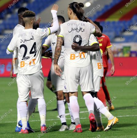 Al-Ittihad's player Aleksandar Prijovic (2-R) celebrates with teammates after scoring a goal during the Saudi Professional League soccer match between Al-Qadisiyah and Al-Ittihad at Prince Mohammed Bin Fahd Stadium, in Dammam, Saudi Arabia, 28 February 2021.