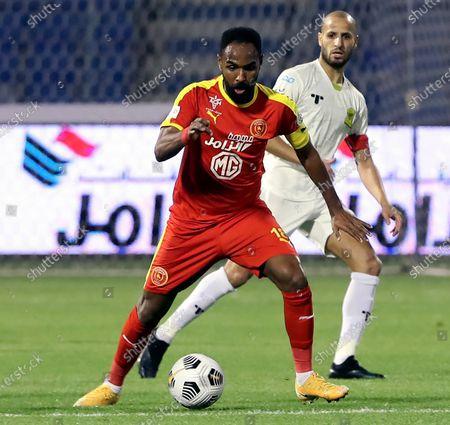 Al-Qadisiyah's player Naif Hazzazi (front) in action against Al-Ittihad's Karim El Ahmadi (back) during the Saudi Professional League soccer match between Al-Qadisiyah and Al-Ittihad at Prince Mohammed Bin Fahd Stadium, in Dammam, Saudi Arabia, 28 February 2021.