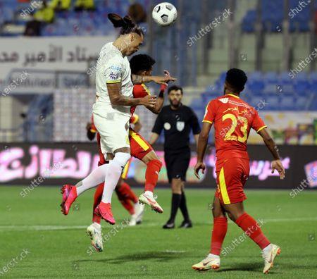 Stock Image of Al-Qadisiyah's player Ibrahim Al-Sheail (R) in action against Al-Ittihad's Aleksandar Prijovic (L) during the Saudi Professional League soccer match between Al-Qadisiyah and Al-Ittihad at Prince Mohammed Bin Fahd Stadium, in Dammam, Saudi Arabia, 28 February 2021.