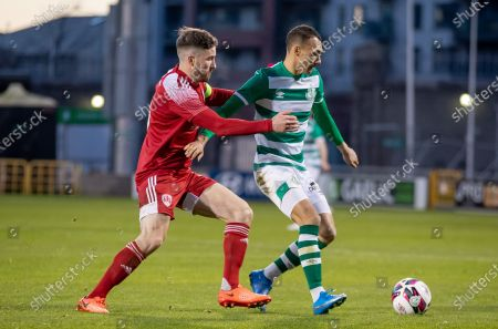 Stock Photo of Shamrock Rovers vs Cork City. Shamrock Rovers' Graham Burke with Gearoid Morrissey of Cork City