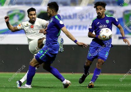 Al-Fateh's player Nawaf Boushal (R) in action against Al-Hilal's Salem Al-Dawsari (L) during the Saudi Professional League soccer match between Al-Fateh and Al-Hilal at Prince Abdullah bin Jalawi Stadium, in Al-Hasa, Saudi Arabia, 28 February 2021.