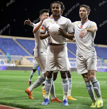 Stock Image of Al-Hilal's player Andre Carrillo (2-L) celebrates with teammates after scoring a goal during the Saudi Professional League soccer match between Al-Fateh and Al-Hilal at Prince Abdullah bin Jalawi Stadium, in Al-Hasa, Saudi Arabia, 28 February 2021.