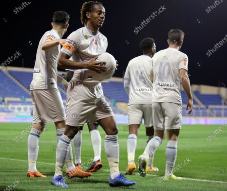 Al-Hilal's player Andre Carrillo (2-L) celebrates with teammates after scoring a goal during the Saudi Professional League soccer match between Al-Fateh and Al-Hilal at Prince Abdullah bin Jalawi Stadium, in Al-Hasa, Saudi Arabia, 28 February 2021.