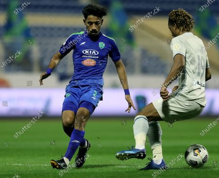 Stock Picture of Al-Fateh's player Nawaf Boushal (L) in action against Al-Hilal's Andre Carrillo (R) during the Saudi Professional League soccer match between Al-Fateh and Al-Hilal at Prince Abdullah bin Jalawi Stadium, in Al-Hasa, Saudi Arabia, 28 February 2021.