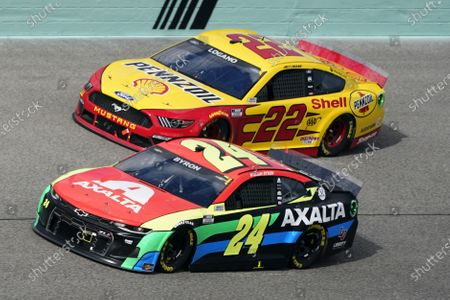 Joey Logano (22) and William Byron (24) battle for position during a NASCAR Cup Series auto race, in Homestead, Fla