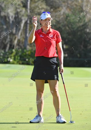 Annika Sorenstam, of Sweden, waves to fans on the putting green during the final round of the Gainbridge LPGA golf tournament, in Orlando, Fla