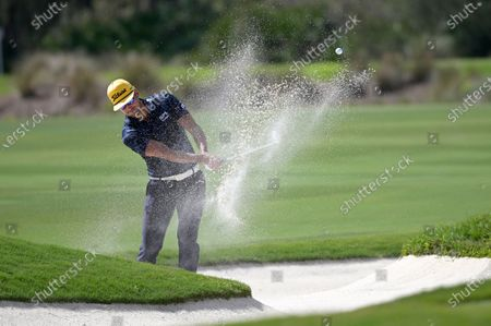 Stock Picture of Rafa Cabrera Bello, of Spain, hits out of a bunker onto the 12th green during the final round of the Workday Championship golf tournament, in Bradenton, Fla
